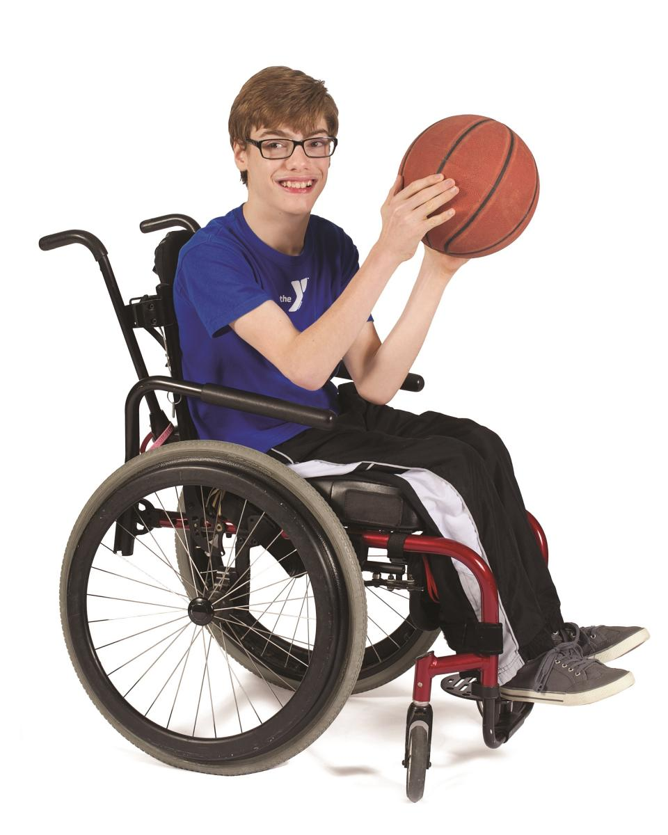 Boy in a wheelchair playing adaptive basketball.