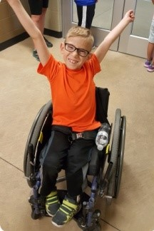 Happy Boy in wheelchair.