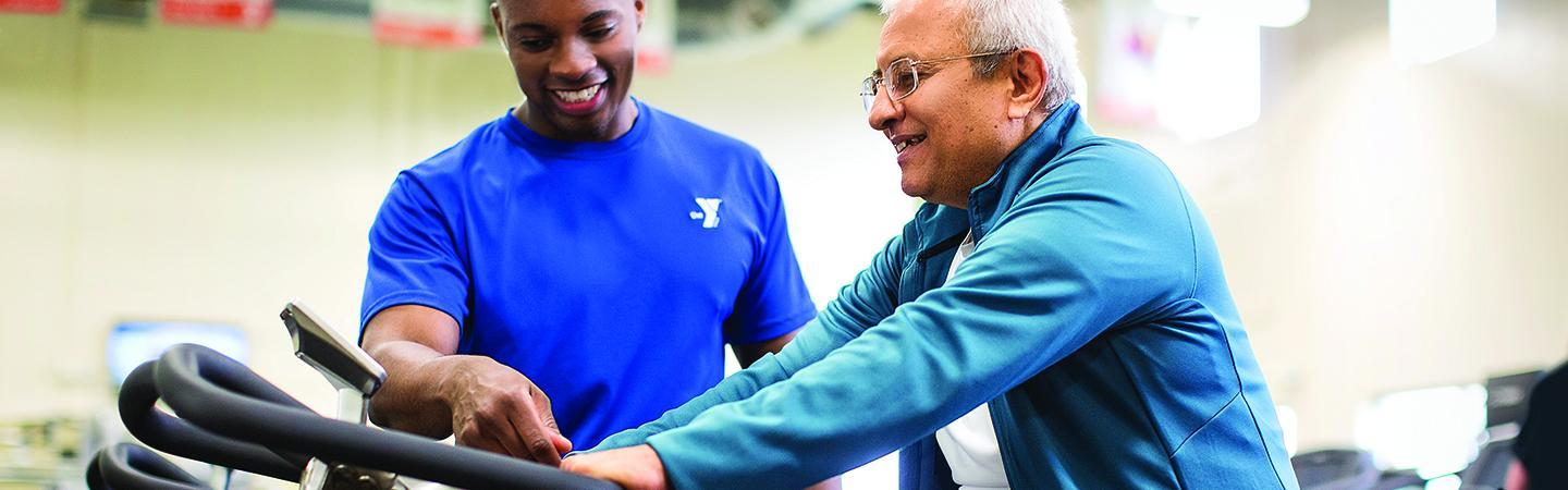 Staff member explaining the benefits of the YMCA to a member.